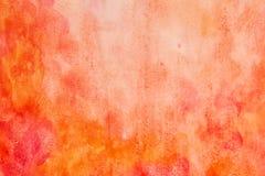 Extracto de la acuarela del rojo anaranjado Foto de archivo