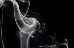 Extracto de la naturaleza: La brizna delicada del humo que forma una cala Fotos de archivo