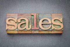 Extracto de la palabra de las ventas en el tipo de madera imagen de archivo