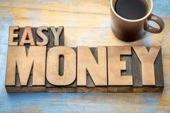 Extracto de la palabra del dinero fácil en tipo de madera de la prensa de copiar Imagen de archivo libre de regalías