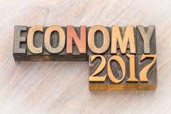 Extracto de la palabra de la economía 2017 en el tipo de madera Imágenes de archivo libres de regalías
