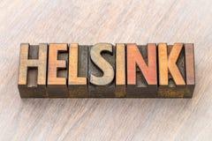 Extracto de la palabra de Helsinki en el tipo de madera Foto de archivo