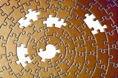 Extracto de rompecabezas en cobre con cinco pedazos que falta Fotografía de archivo libre de regalías