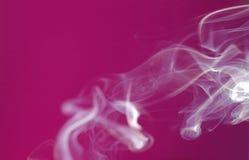 Extracto del humo del color de rosa caliente Fotos de archivo libres de regalías