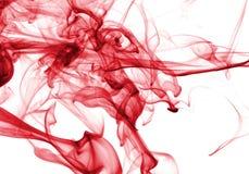 Extracto del humo en rojo imagen de archivo