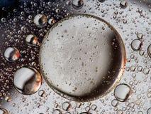 Extracto rojo y gris, del aceite y de la burbuja negro del líquido fotos de archivo