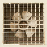 Extractor fan. Propellers behind metal grid Royalty Free Stock Image
