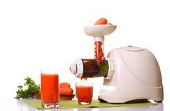 Extractor y zanahoria del jugo Foto de archivo libre de regalías