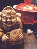 Extranahaufnahme, die Teegottstatue, die Teezeremonie, lizenzfreie stockbilder