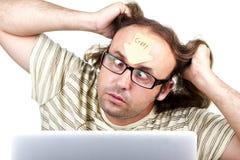 Extraño-loco-hombre-con-ordenador portátil Foto de archivo libre de regalías