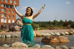 Extraordinarily beautiful girl in a blue dress Stock Photos