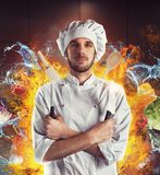 Extraordinary chef. Chef with knives between water and fire Stock Photos