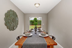 Extraordinary  dinning room with grey walls and long table. Stock Photography