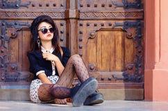 Extraordinary girl posing on the ground Stock Photography