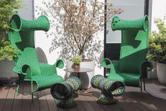 Extraordinary green chairs on patio Royalty Free Stock Photo