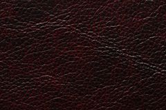 Extraordinary leather texture in dark black red tones. royalty free stock photography