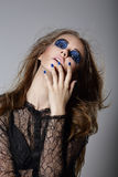 Extravagance. Fancy Woman with Blue Dramatic Makeup and Manicure. Unusual Girl with Blue Dramatic Make-up posing Royalty Free Stock Photography
