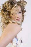 Extravagant bride. Beautiful blonde in wedding white gown Stock Photos