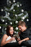 Extravagant couple with champagne on Christmas Stock Image