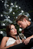 Extravagant couple with champagne on Christmas Royalty Free Stock Image
