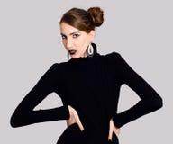 Extravagant lady in black Stock Image