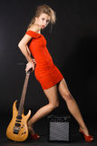Extravagant model with a music equipment Stock Images