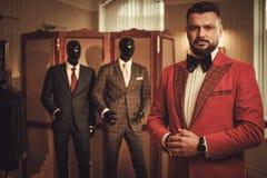 Extravagant stylish man in tailor studio Stock Photo