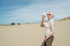 Extravagant woman doing selfie on vacation Stock Photos