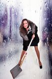 Extravagant woman in a half hem with a shovel for snow removal on an abstract background.  stock photos