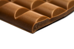 Extreem macroschot van chocoladestuk, op wit Stock Fotografie