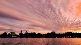 Pink cloud Sunrise Seascape Australia. An extreem Pastel Pink coloured cloud sunrise seascape over sea water with water reflections. Queensland, Australia Royalty Free Stock Images