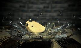 Coin Hitting Water Splash Royalty Free Stock Photography
