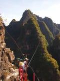 Extrem cykelspänd lina i Kina Arkivbild