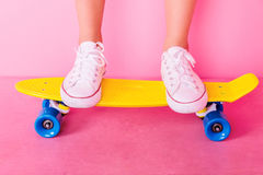 Extrem girl with skateboard. Conceptual shooting of girl`s feet standing on the skateboard Stock Images