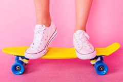 Extrem girl with skateboard. Conceptual shooting of girl`s feet standing on the skateboard Stock Photography