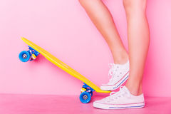 Extrem girl with skateboard. Conceptual shooting of girl`s feet standing on the skateboard Stock Photos
