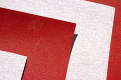 Extreme Abstracte Close-up van Bladen van Rood en Grey Sandpaper Royalty-vrije Stock Afbeeldingen