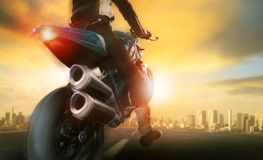 Extreme action of man riding on big motorcycle. Extreme action of man riding  on big motorcycle Stock Photo