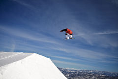 Extreme action sport snowboarder jumping big air Stock Photos