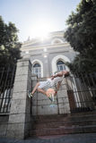 Extreme athlete doing a backflip in front of a building Stock Images