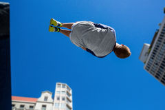 Extreme athlete jumping in the air stock photography