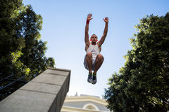 Extreme athlete jumping in the air in front of a building Royalty Free Stock Images