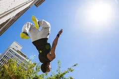Extreme athlete jumping in the air in front of a building Stock Images