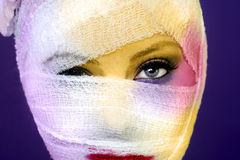 Extreme Beauty Concept of Heavy Makeup Seeping Through Gauze Stock Images