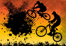 Extreme bicycle jumping with grunge background Stock Photo