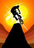Extreme bicycle racing jump on the mountain vector. The rider playing extreme bicycle racing jump on the mountain vector Royalty Free Stock Image