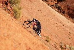 Extreme biker uphill. In red canyon Royalty Free Stock Photo