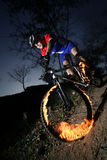 Extreme bikers. Man ride his mountain bike, burning tires Stock Photo