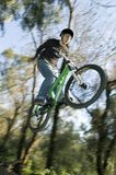 Extreme bikers. Extreme riders flying with they bikes Stock Photography