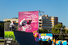 Extreme BMX rider in helmet in skatepark on competition Stock Photos